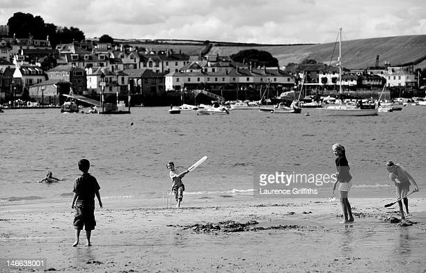 A young boy plays cricket on the beach in the Kingsbridge Estuary on August 8 2008 in Salcombe England