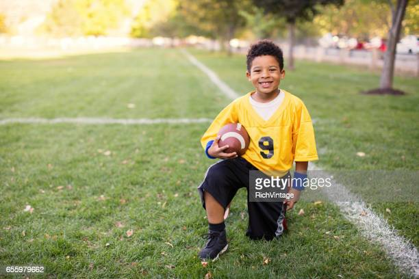 A Young Boy Plays Flag Football
