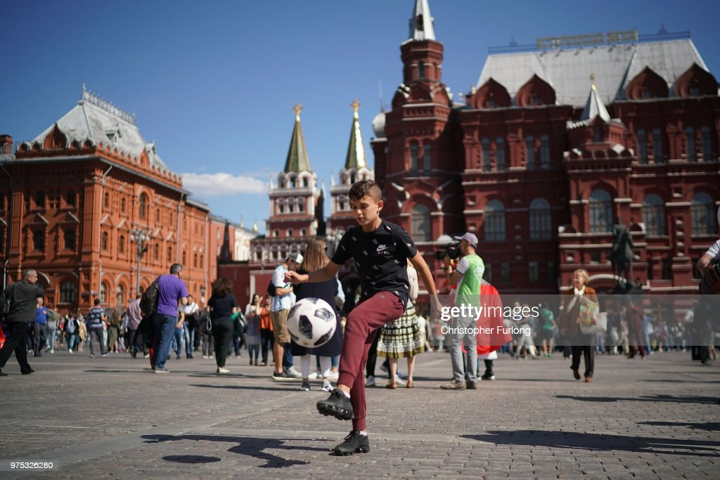 A young boy plays football and joins in the fun atmosphere of The World Cup near Red Square on June 15, 2018 in Moscow, Russia. Russia won the opening game of the tournament against Saudi Arabia 5-0.
