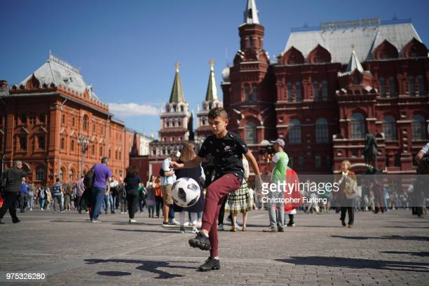 A young boy plays football and joins in the fun atmosphere of The World Cup near Red Square on June 15 2018 in Moscow Russia Russia won the opening...