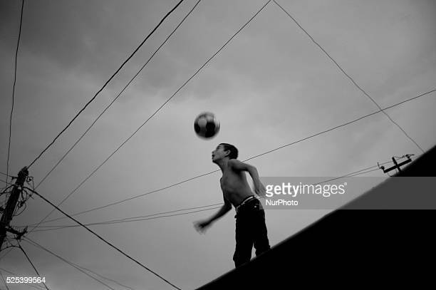 A young boy plays football in the neighbourhood of Kond in Yerevan Armenia on February 16 2016 Where an ongoing Government gentrification initiative...