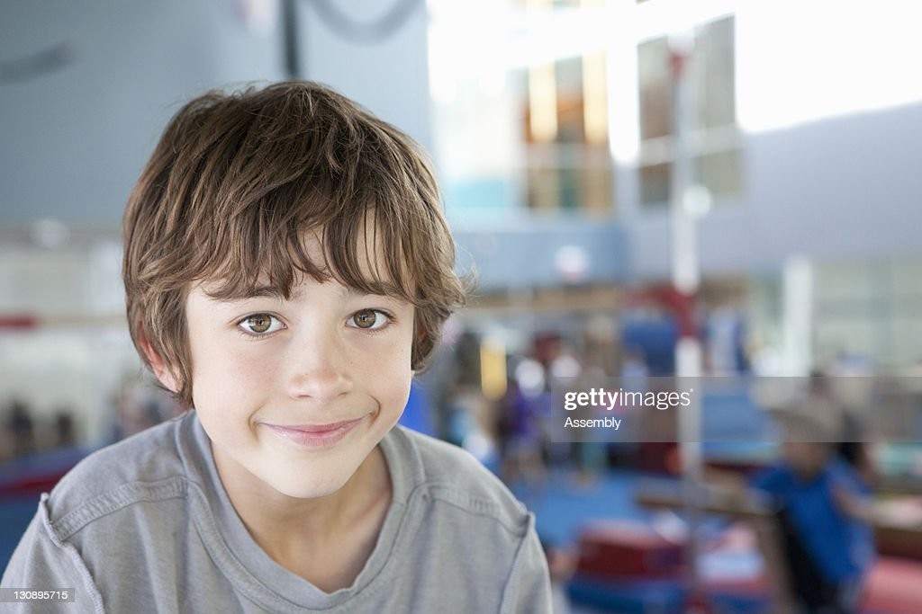 Young boy plays in a gymnasium : Stock Photo