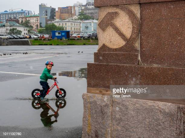 A young boy plays in the Square of the Fighters for Soviet Power in Vladivostok a major Pacific port city in Russia overlooking Golden Horn Bay near...