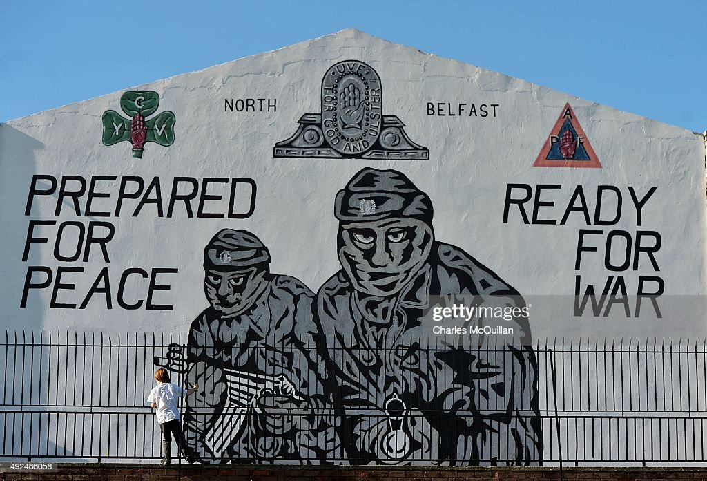 A young boy plays near a loyalist paramilitary mural on the day that the new Loyalist Community Council was launched at the Park Avenue Hotel on October 13, 2015 in Belfast, Northern Ireland. The council has the backing of the three main loyalist paramilitary groups, the UVF, the UDA and the Red Hand Commandos. A joint statement from the three loyalist groups said that they are 're-committing to the principals of the Belfast Agreement' and that they 'eschew all violence and criminality'. The launch of the new loyalist community council comes against the backdrop of an ongoing crisis at Stormont following following allegations that the IRA were involved in the murder of their former member Kevin McGuigan.