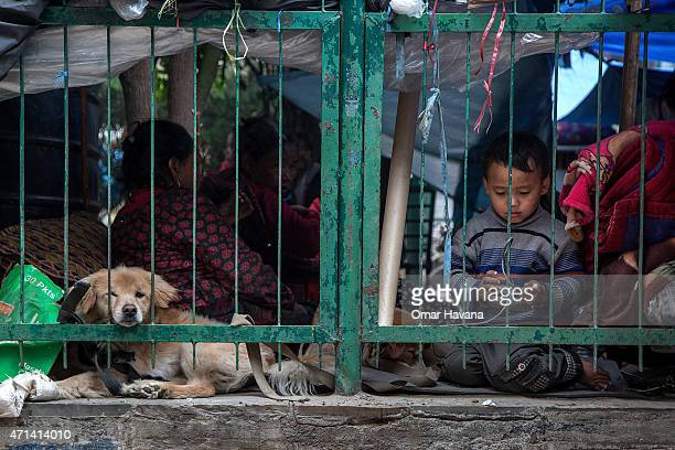 Young boy plays with a rope in a square where residents have taken shelter on April 28, 2015 in Kathmandu, Nepal. A major 7.8 earthquake hit...
