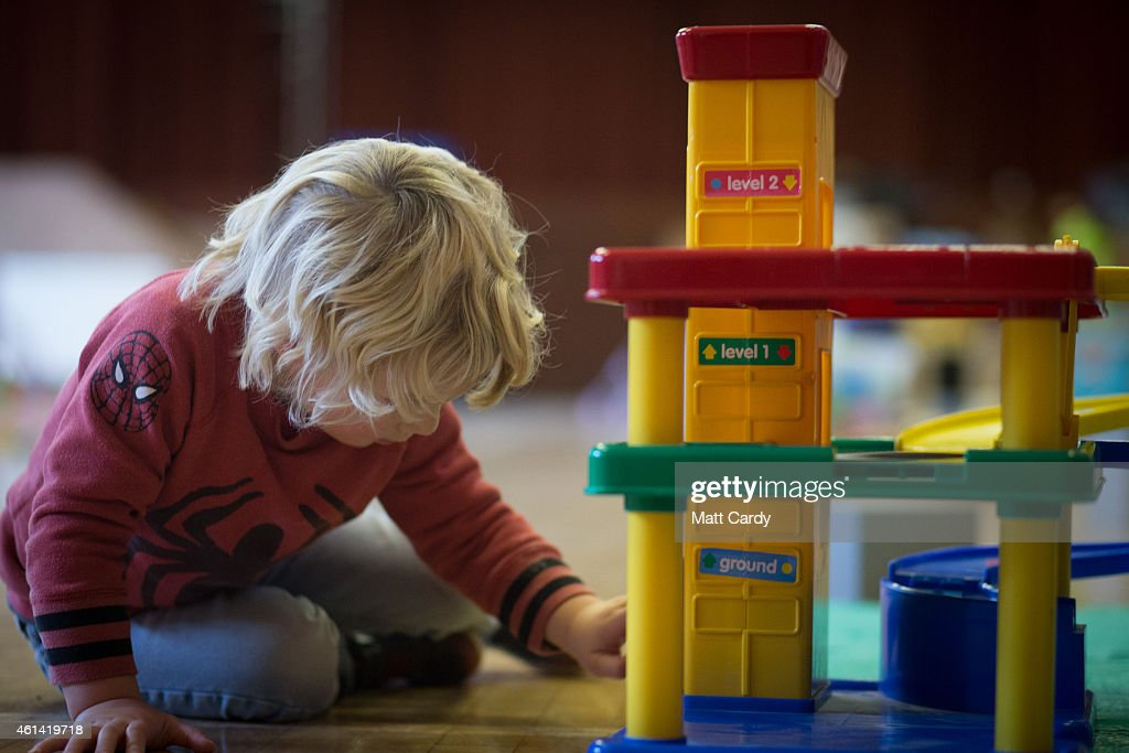 A young boy plays with toys at a playgroup for pre-school aged children in Chilcompton near Radstock on January 6, 2015 in Somerset, England. Along with the health and the economy, education and childcare are to be key issues in the forthcoming election.