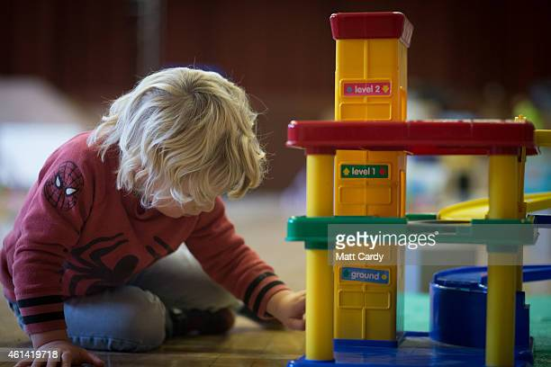 A young boy plays with toys at a playgroup for preschool aged children in Chilcompton near Radstock on January 6 2015 in Somerset England Along with...