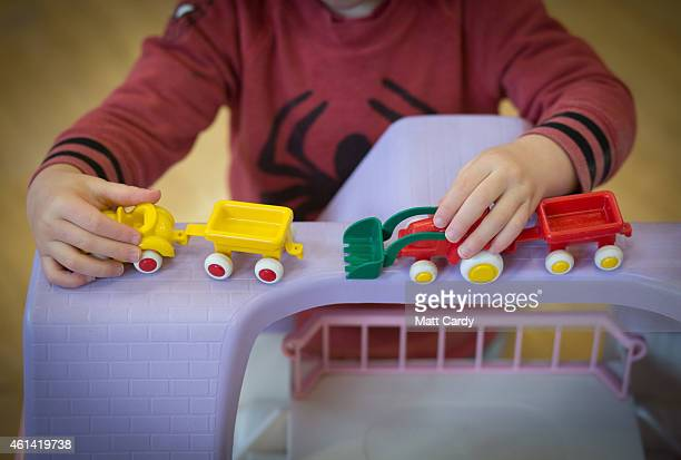 Young boy plays with toys at a playgroup for pre-school aged children in Chilcompton near Radstock on January 6, 2015 in Somerset, England. Along...