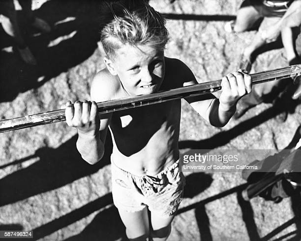 A young boy practices his chinups on playground bars dwa8407isla