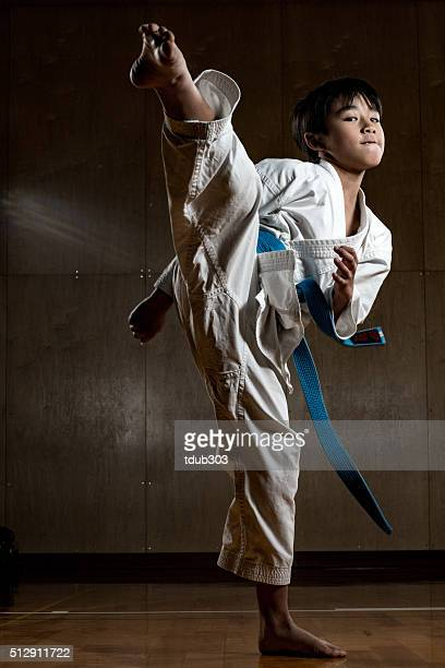 young boy practicing karate - martial arts stock pictures, royalty-free photos & images