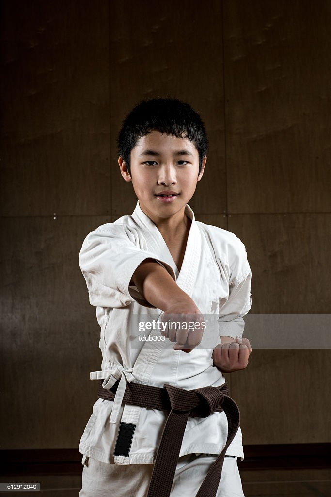 Young boy practicing karate : Stock Photo