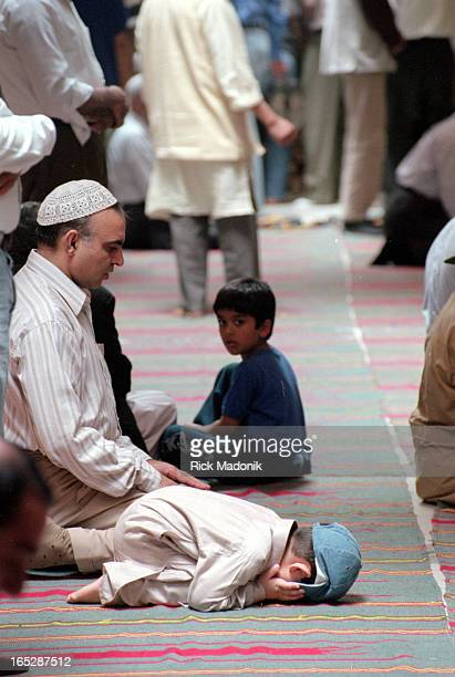 Young boy prays at the Islamic Foundation of Toronto mosque in Scarboro during the mid afternoon prayer on Friday, the sabbath for followers of the...