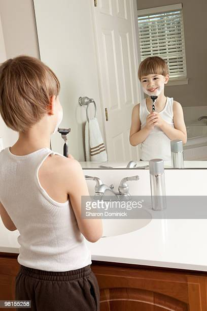 Young Boy Pretending To Shave
