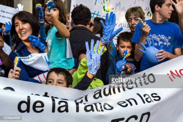 Young boy protesting and demanding no more than five Pervasive Developmental Disorders students in classrooms during a protest in front of the...
