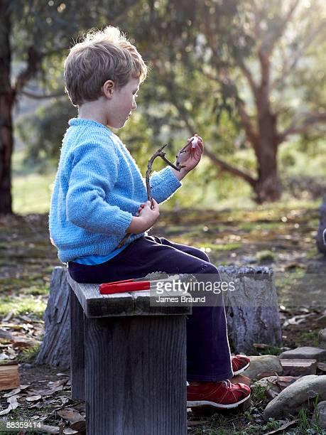 young boy putting marshmallow ont - sentar se imagens e fotografias de stock