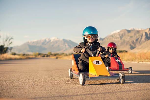 Young Boy Races Toy Car Wearing Business Suit Wall Art
