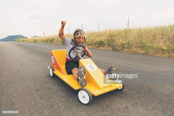 young boy racing homemade car - race car driver stock pictures, royalty-free photos & images