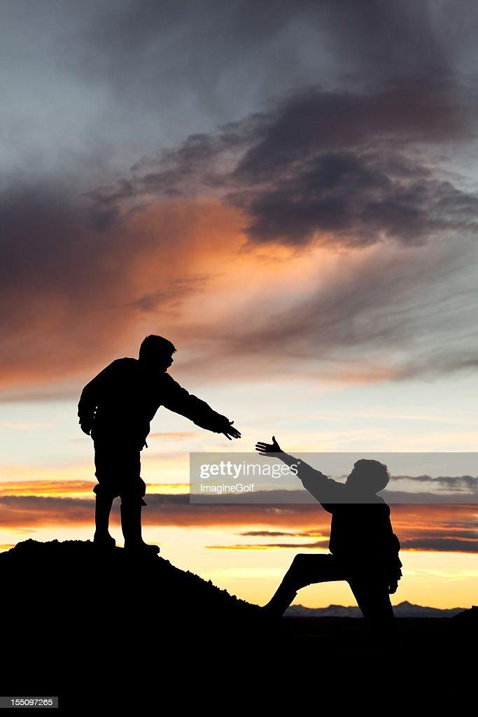 Boy helping hand