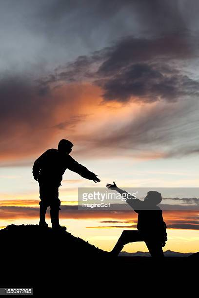 Young Boy Reaching Out To Lending A Helping Hand