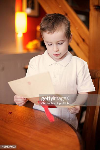 Young boy reading a very important letter
