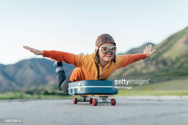 young boy ready to travel with suitcase - volare foto e immagini stock