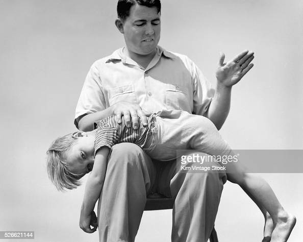 A Young Boy Receives A Spanking From His Father In This Staged News Photo - Getty -4689