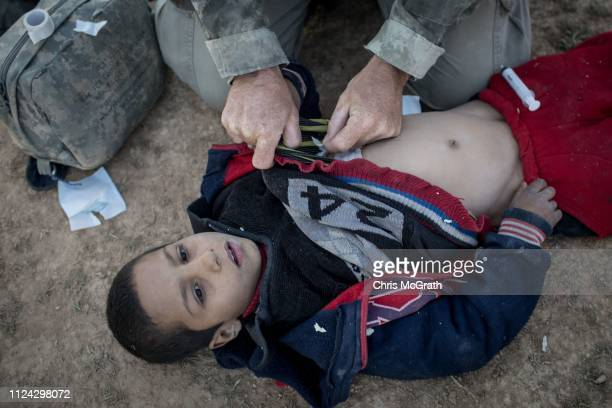 Young boy receives medical treatment for a gunshot wound by a member of the Free Burma Rangers medical unit after arriving at an SDF position on the...