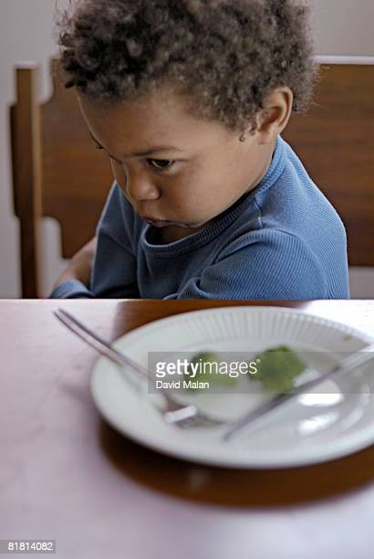Young boy refusing to eat broccoli, Cape Town, Western Cape Province, South Africa