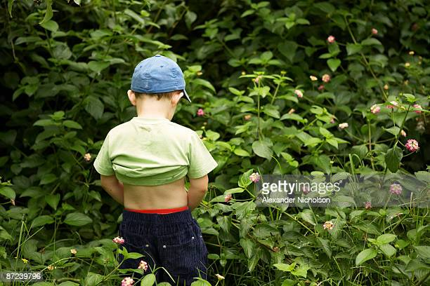 young boy relieving himself - urinating stock pictures, royalty-free photos & images
