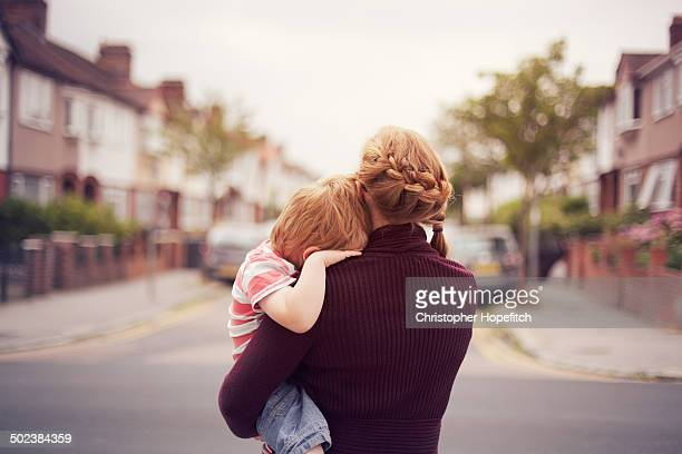 young boy resting on mother's shoulder - back stock pictures, royalty-free photos & images