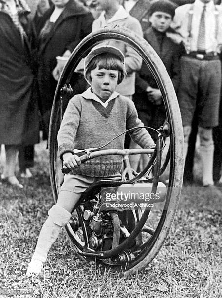 A young boy rides his new type of motorcycle the spokeless wheel where the rider sits inside the wheel and the wheel turns but not the rider Paris...