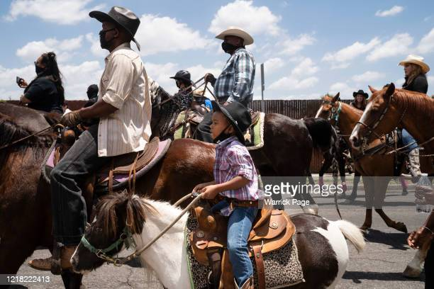 Young boy rides with the Compton Cowboys during a 'peace ride' for George Floyd on June 7, 2020 in Compton, California. This is the 13th day of...