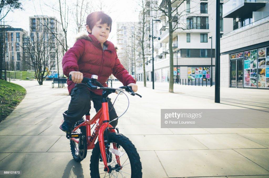 Young boy riding a bike : Stock Photo