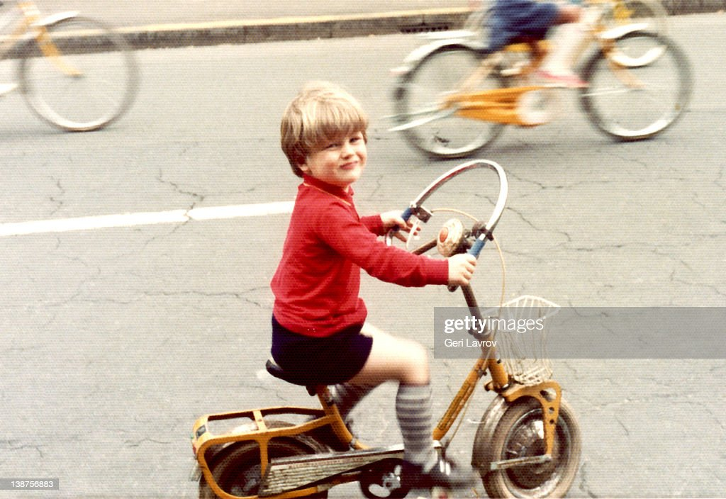Young boy riding bicycle : Stock Photo