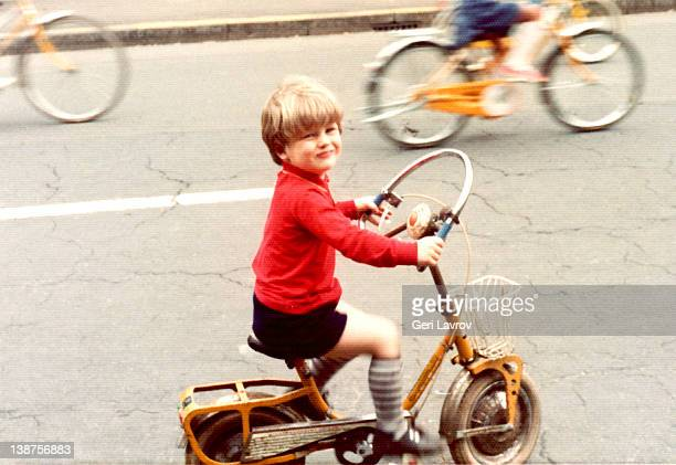 young boy riding bicycle - archivmaterial stock-fotos und bilder