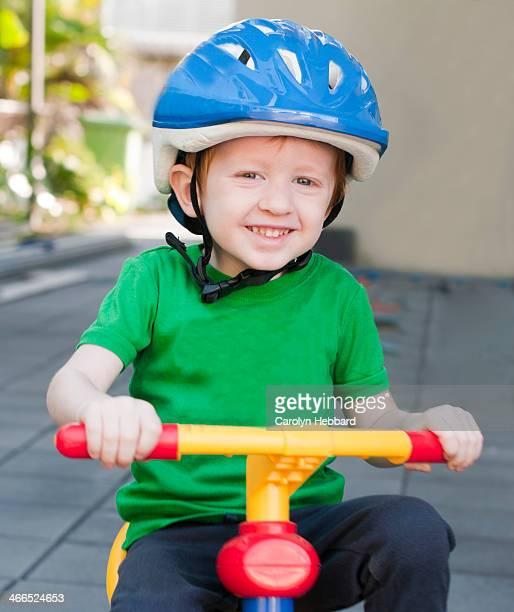 Young Boy Riding Bike in Helmet