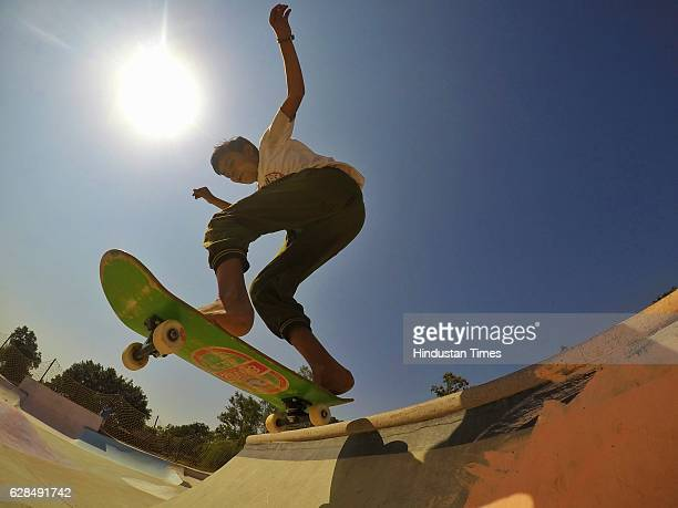 Young boy riding on a skateboard at Skating Park, popularly known as Janwaar Castle, on October 26, 2016 in Janwaar, India. Thanks to a German...