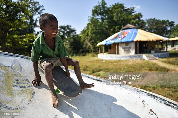 A young boy riding on a skateboard at Skating Park popularly known as Janwaar Castle on October 26 2016 in Janwaar India Thanks to a German community...