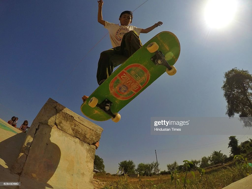 A young boy riding on a skateboard at Skating Park, popularly known as Janwaar Castle, on October 26, 2016 in Janwaar, India. Thanks to a German community activist and author Ulrike Reinhard, skateboarding is slowly changing the children in this Madhya Pradesh village divided by caste. Located along the fringes of the Panna National Tiger Reserve, the Janwaar Skating Park is a not-for-profit project that teaches village children skateboarding free of cost. The park is a place for unfettered fun, but has two strict ground rules. Rule number one: Girls first. And rule number two: No school, no skateboarding. The park also bridges caste disparities by bringing together the village Adivasi and upper caste Yadav and Kushwaha children to play together.