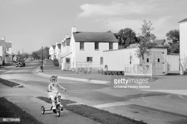 Young Boy Riding Tricycle, Greendale, Wisconsin, USA, a Greenbelt Community Constructed by U.S. Department of Agriculture as Part of President...