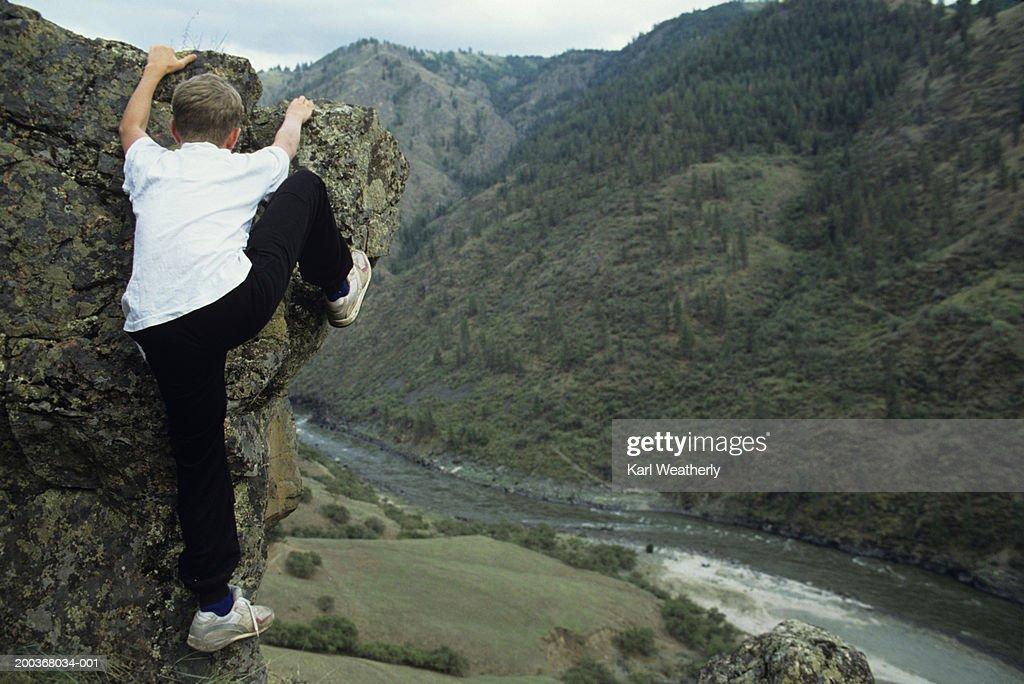 Young boy rock climbing, Lower Salmon, Indiana, USA : Stock Photo