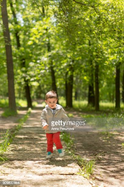 Young boy running towards camera