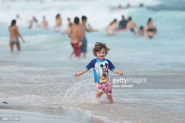 A young boy runs in the water at Coogee beach on December 14 2017 in Sydney Australia The bureau of meteorology has forecast temperatures over 40...
