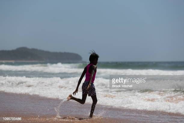 A young boy runs into the surf for the first time ever at South Narrabeen Beach on January 18 2019 in Sydney Australia The 40 children from Far North...