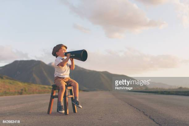 Young Boy Salesman Gives Good News through Megaphone