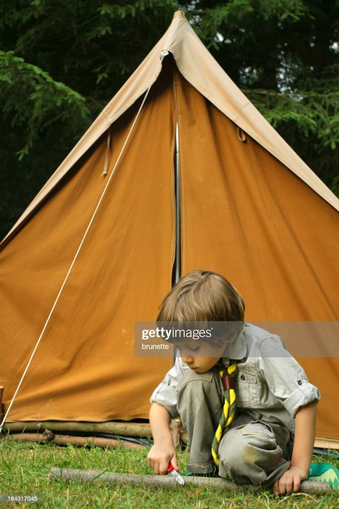 Young Boy Scout carving wood in front of a tent & Boy Scout Stock Photos and Pictures | Getty Images