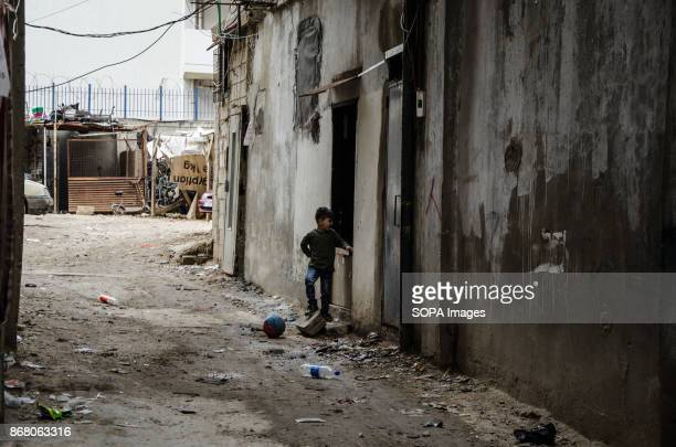 A young boy seen playing with a ball in Shatila refugee camp Lebanon host over a million of refugees that had fled from the neighboring country...