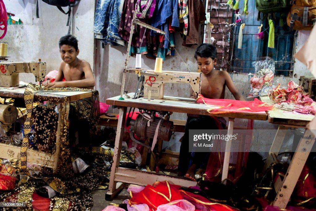 Young boy sews a cloth in a local garment shop in Dhaka,... : News Photo