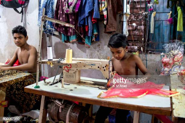 SADARGHAT DHAKA BANGLADESH Young boy sews a cloth in a local garment shop in Dhaka Bangladesh World Day Against Child Labor was observed on 12 June...