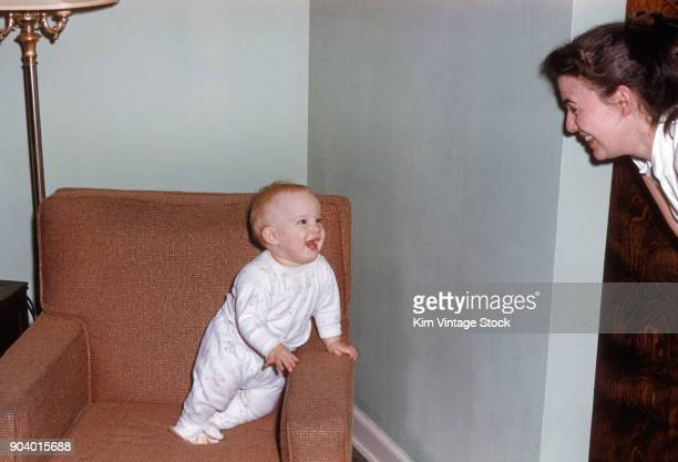 Young boy shares a laugh with his mother, ca. 1960.